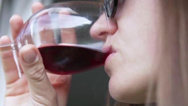 Woman drinking red wine from a glass goblet