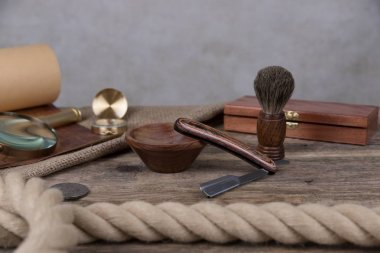 shaving accessories  - wooden razor with shaving brush and shaving foam on a rustic wooden background