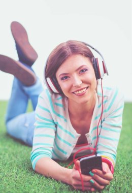 Young woman listening to the music . Young woman