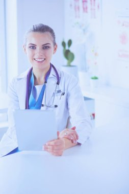Close up Portrait of friendly female doctor with stethoscope and tablet in hands.