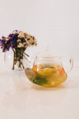 tea in a glass teapot on a white background