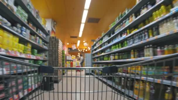 Shopping cart moving in supermarket