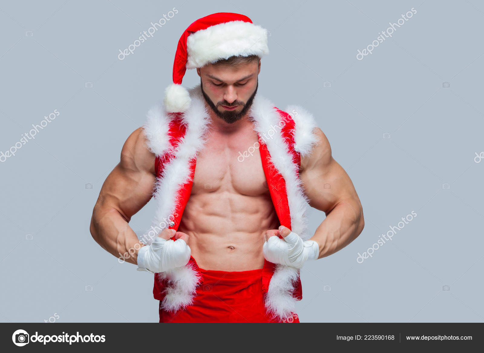 0bff02e07f933 Christmas. Sexy Santa Claus . Young muscular man wearing Santa C– stock  image
