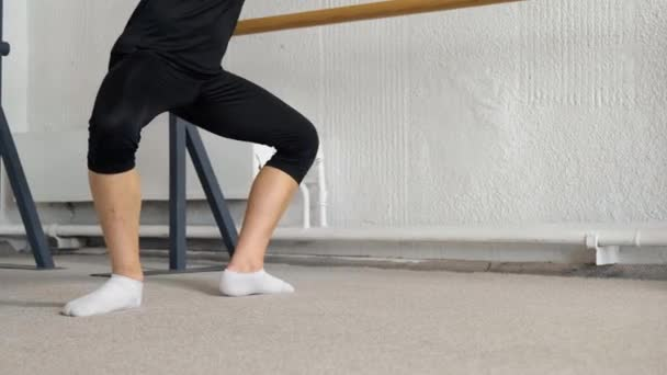Dance training at a ballet school, for children, boys and girls. Second position