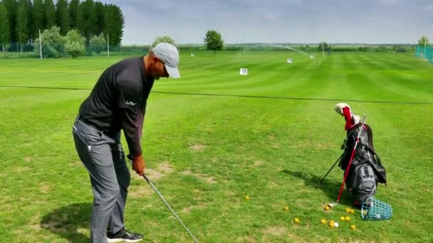 Zrenjanin, Serbia 22.05.2018: Professional golf player performs a proper golf stroke, 4k Video Clip
