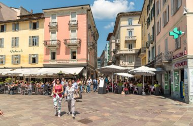 Lugano, Ticino, Switzerland - July 27, 2018: View of Piazza della Riforma with many bars, restaurants and bistros, is main square in the historic center of Lugano.