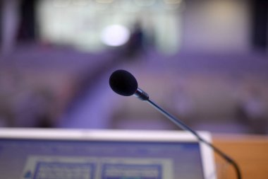 Microphones and monitors at conference hall during business conf