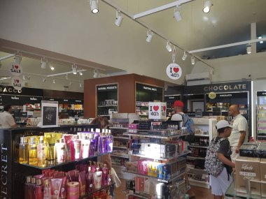 RHODES, GREECE - AUGUST 26, 2017: people buying goods in shop stock vector