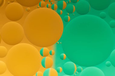 Oil and water abstract in orange and green