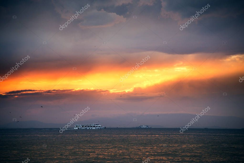 Aegean sea and Izmir bay and on cloudy sunset landscape.