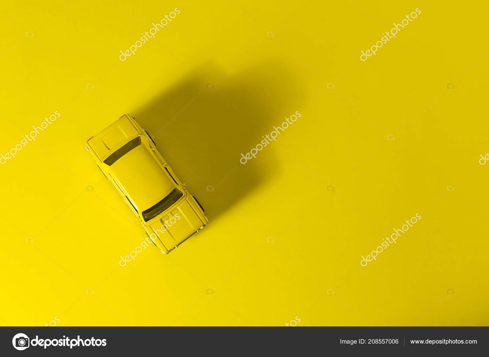 Yellow Toy Car Top View Yellow Background Long Side Shadow Stock