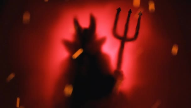 Animated Creepy Devil silhouette from hell in the mist with backlit.