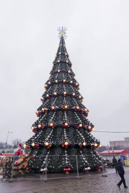 Kharkiv, Ukraine - December 30, 2017 Huge pine tree  at Freedom square in Kharkiv Ukraine at christmas time and with people.