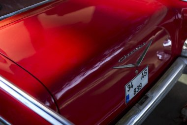 Back side logo of a Red 1957 Chevrolet.