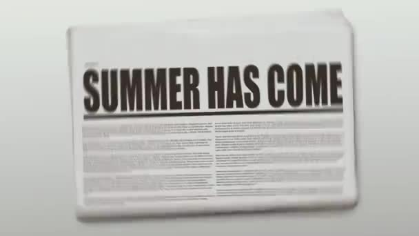 Summer Has Come written and rotating newspaper on 4K footage.