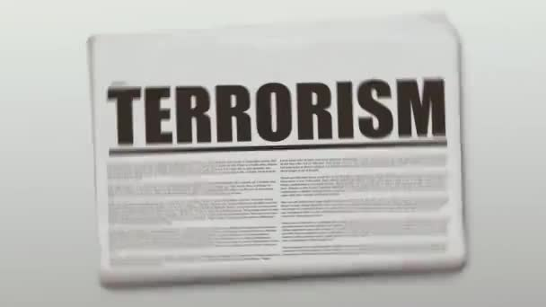 Rotating and Terrorism written newspaper animated on a gradient background.