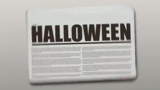Rotační noviny s textem, který je Halloween.