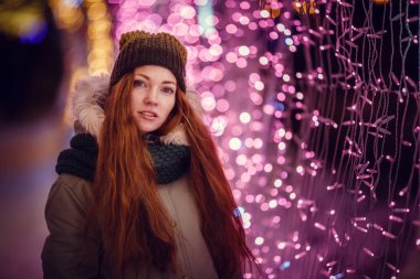 Funny red hair girl portrait. Vogue fashion style portrait of young pretty beautiful woman with long red curly hair.