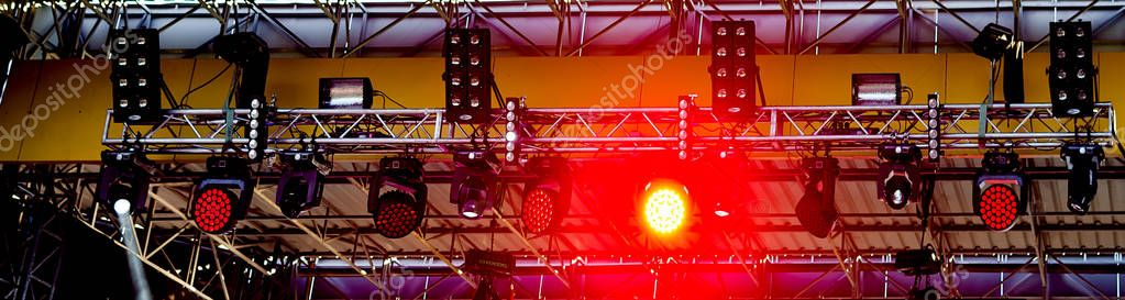Red stage spotlights and illumination equipment on stage background or disco