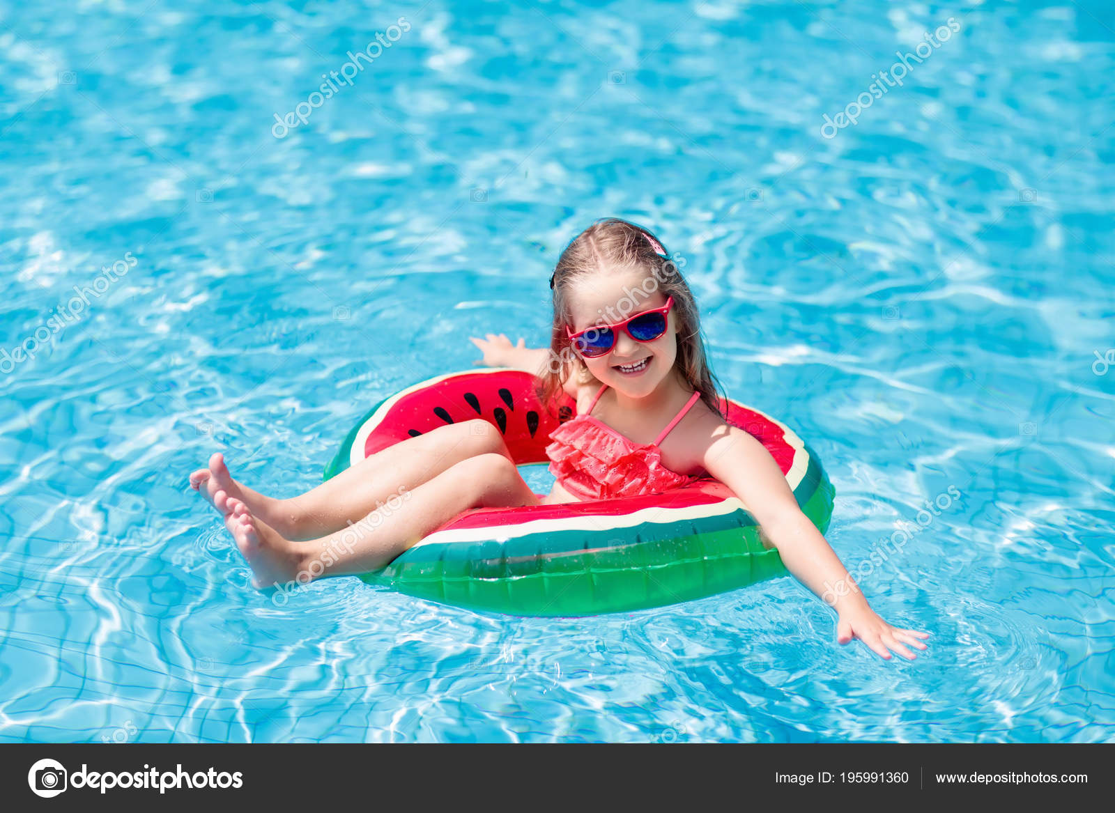 827de6c9b3 Child with watermelon inflatable ring in swimming pool. Little girl learning  to swim in outdoor pool of tropical resort. Kid eye wear.