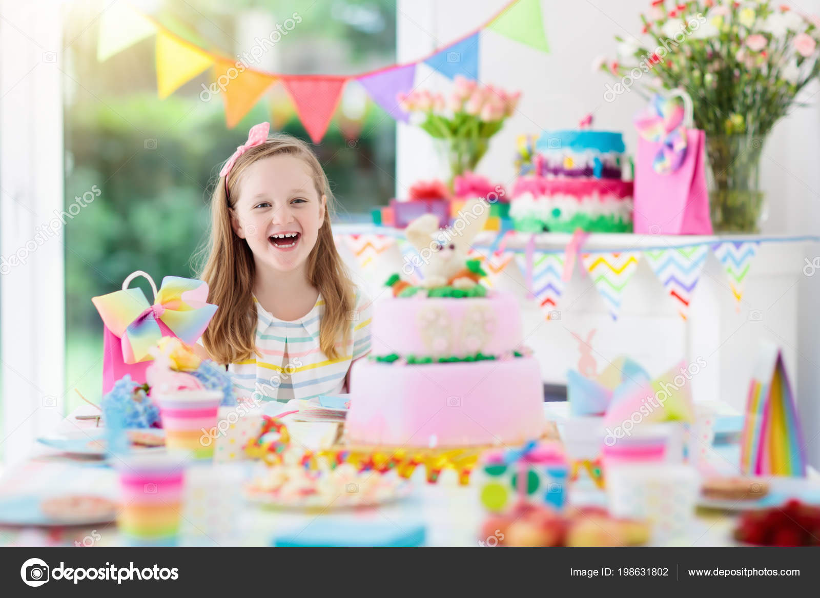 Kids Birthday Party With Colorful Rainbow Pastel Decoration And Bunny Layer Cake Little Girl Sweets Candy Fruit Balloons Banner At Festive