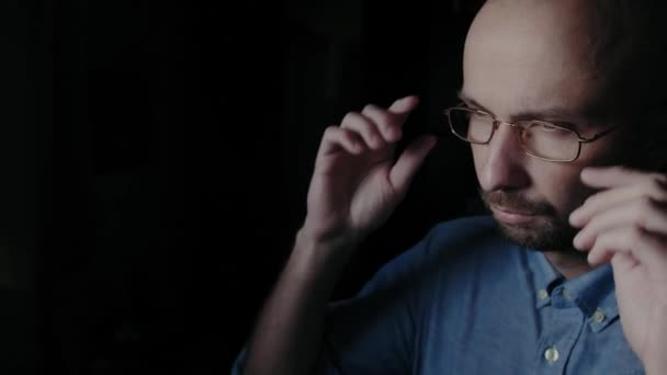 Dissatisfied man with glasses