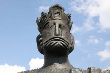 Head Shot Of Bronze Statue Against Blue Sky