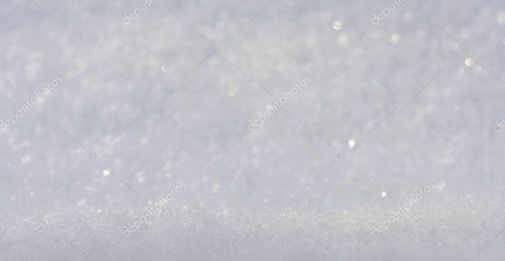 The texture of snow. Snow surface close-up. Snow texture background. The structure of the snow.