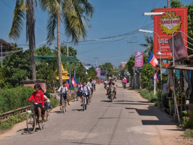 School children on their way home from school at lunchtime on a sunny day - taken on Silk Island / Koh Dach, Phnom Penh, Cambodia