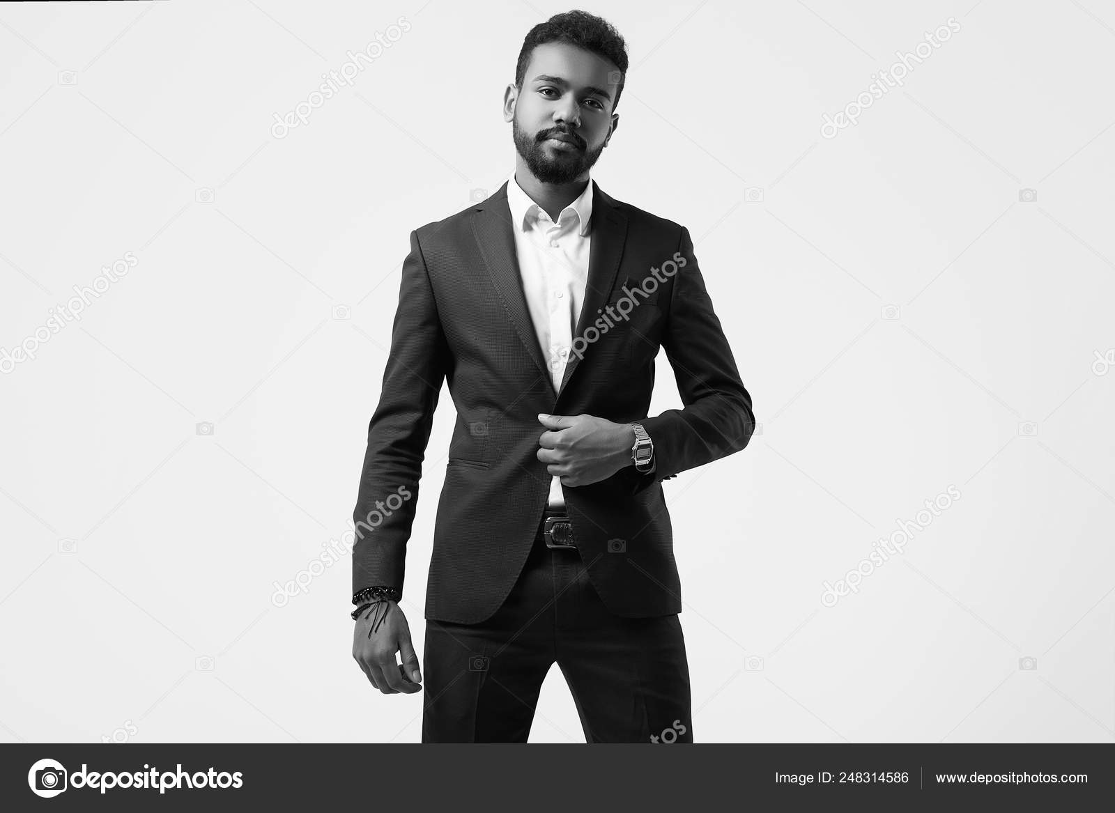 Brutal young african american male model in formal fashion suit stock image