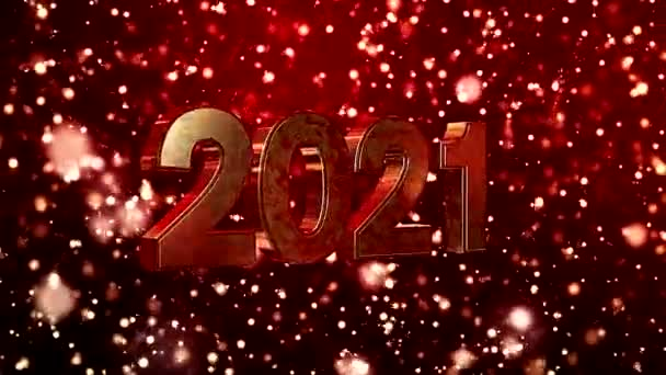 Video animation of christmas golden light shine particles bokeh over red background and the numbers 2021 - represents the new year - vacation concept