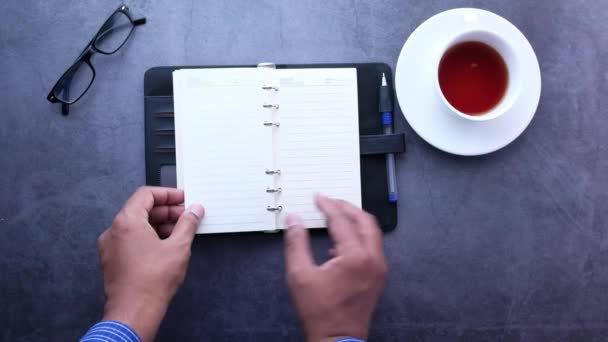 man hand turning a page of a notepad, Top view