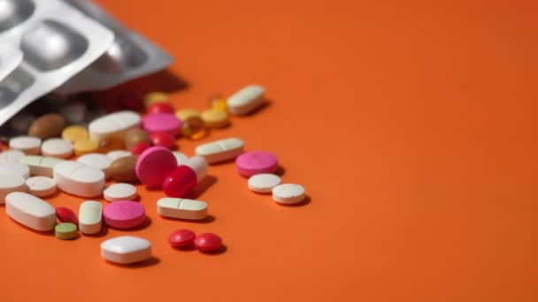 Close up of colorful pills spilling on dray desk