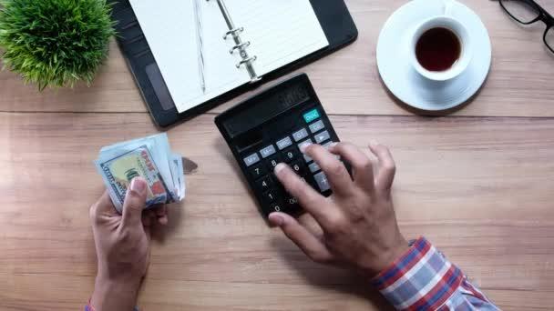 Man hand using calculator on office desk