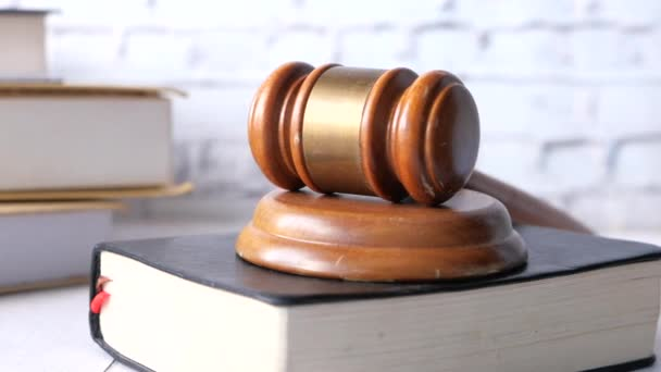 close up of gavel on a book on table