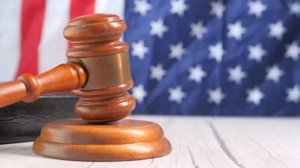 Closeup of gavel and book against american flag