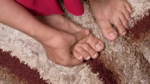 Close up on women feet and hand massage on injury spot.