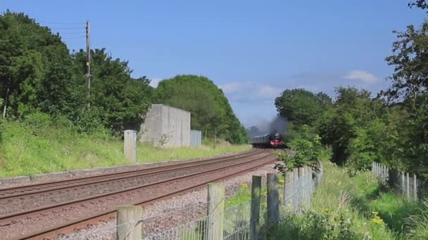 Steam train, Royal Scot, heads The Lakelander through the countryside in West Curthwaite in Cumbria, Northern England.