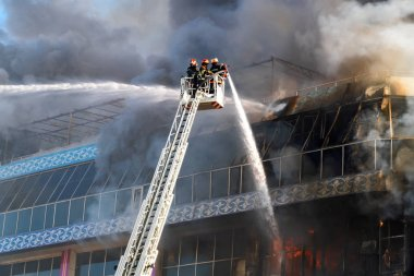 Firefighters on the stairs extinguish a big fire