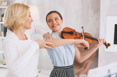 Joyful girl looking at her tutor