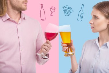 Calm couple clanging glasses while drinking alcohol