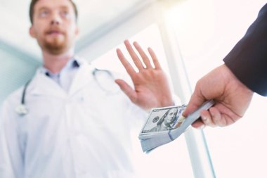 Honest doctor refusing to take a bribe