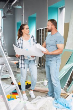 Serious man discussing renovations with a woman