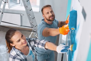 Content painters doing renovations in the apartment