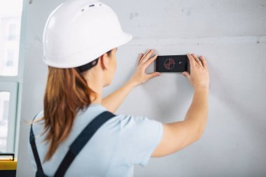 Professional builder remodeling a house