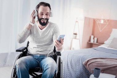Joyful crippled man listening to music