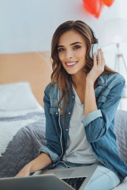 Delighted happy woman listening to music