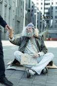 Fotografie Homeless vagrant searching for any job
