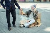 Fotografie Homeless non-conformist begging for job