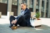 Fotografie Wrinkled man feeling heartbroken after dismissal